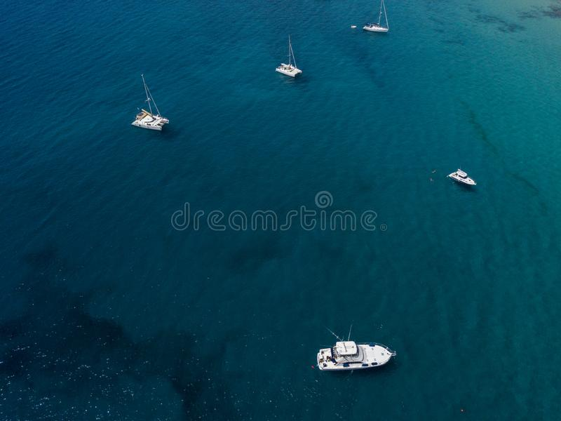 Aerial view of moored boats floating on a transparent sea. Canary Coast, Lanzarote. Spain stock images