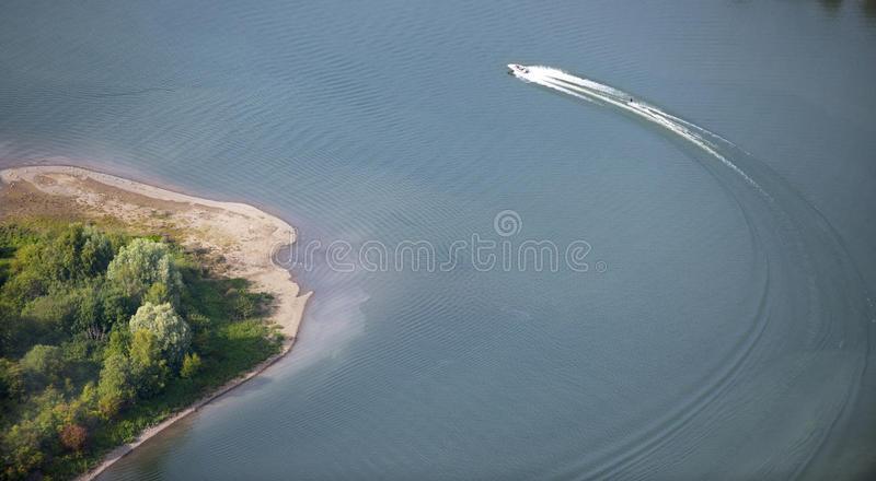 Aerial View : Motorboat waterskiing on a lake royalty free stock image