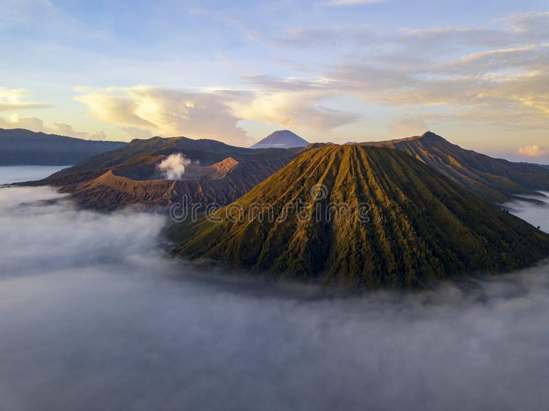 Aerial view of Mount Bromo, East Java, Indonesia. Sunrise at Bromo Tengger Semeru National Park in East Java, Indonesia taken with a drone. Low clouds visible stock images
