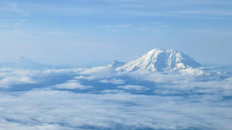 The aerial view of mount rainier, mount adams and mt st helens near seattle stock images