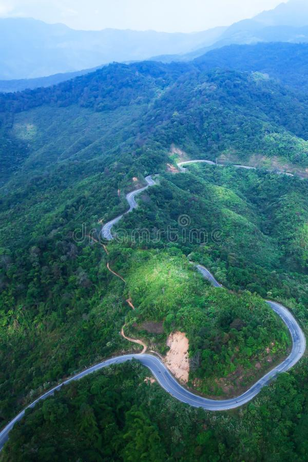 Aerial view of mountain asphalt road and dirt road stock photo