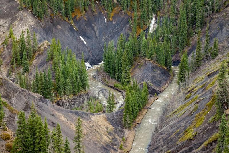 Aerial view of a mountain creek in a deep canyon stock photos