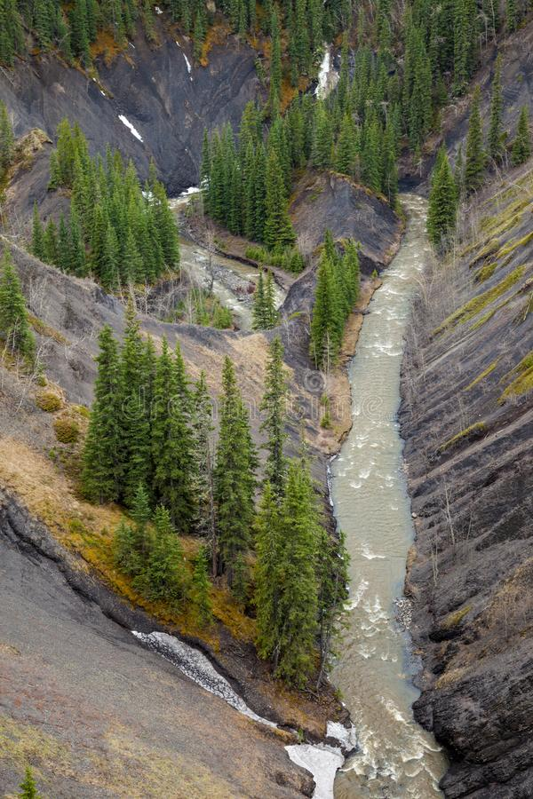 Aerial view of a mountain creek in a deep canyon royalty free stock images