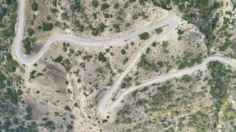Aerial view of mountain curve road at sunset in summer. Top view from flying drone stock photo
