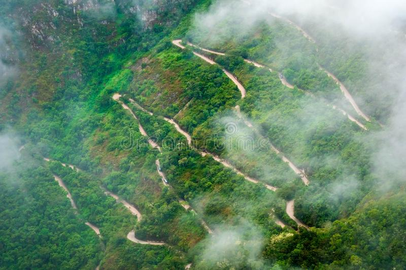Aerial view of mountain forested serpetine road in Machupicchu. Aerial view of mountain forested serpetine road coverd with clouds in Machupicchu royalty free stock photography