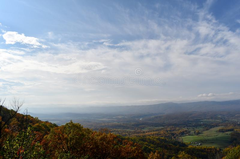 Aerial view of mountain forests in bright autumn colors royalty free stock images