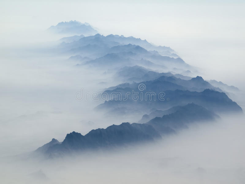 Blue mountains in the mist stock photography