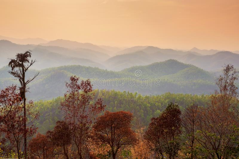 Aerial view of mountain range with warm sunlight, shade and shadow, sunset sunrise. From Mae Hong Son province Thailand stock photo