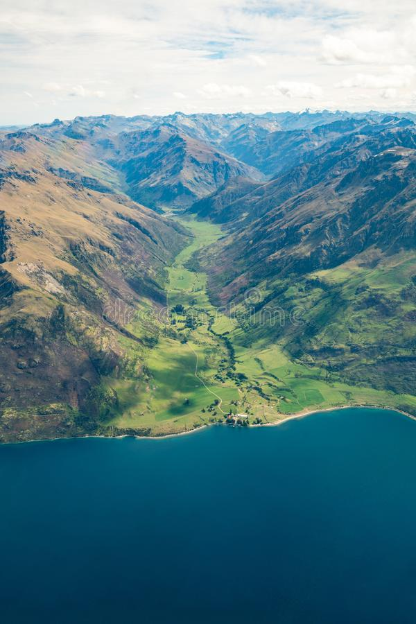 Aerial view of mountain ranges and lake landscape stock image
