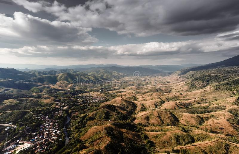 Aerial view of mountains and cloudy skies. Aerial view of rural villages in northeastern Thailand, with mountains and cloudy skies stock photo