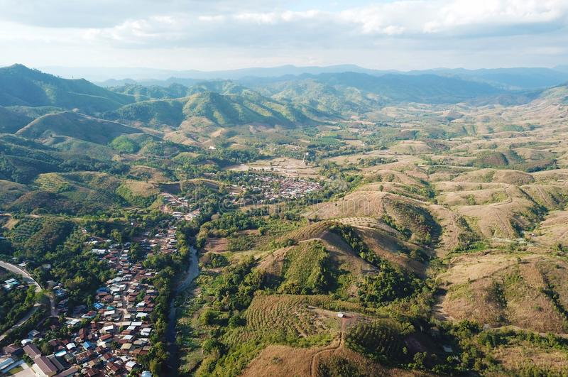 Aerial view of mountains and cloudy skies. Aerial view of rural villages in northeastern Thailand, with mountains and cloudy skies stock images