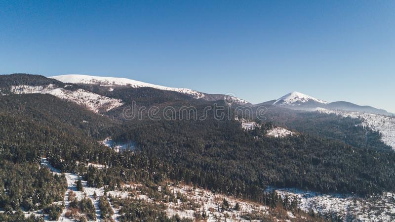 Aerial view of the mountains. Snow. Winter. stock photo