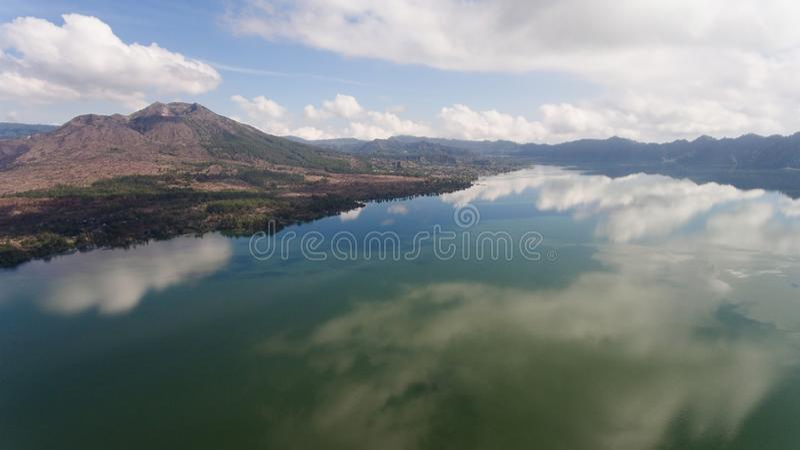 Lake and volcano Batur. Bali,Indonesia. Aerial view Mountains, volcanoes, crater lake Batur, Bali, Indonesia. Mountain landscape with volcanoes, lake, sky and stock image