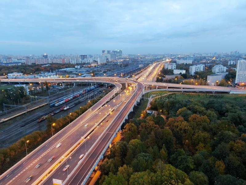 Aerial view of the multi-level junction of the high-speed highway in the center of the big city. Drone panorama stock photos