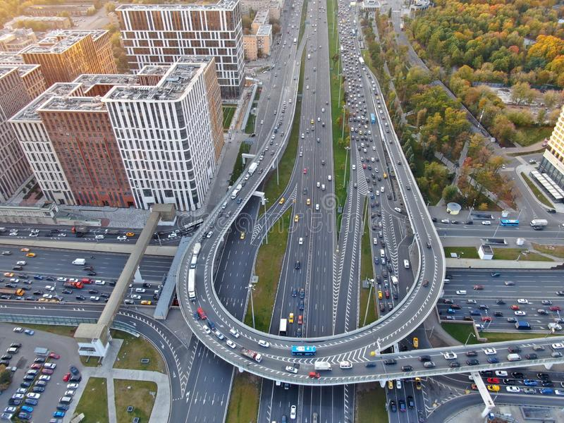 Aerial view of the multi-level junction of the high-speed highway in the center of the big city. Drone panorama stock image