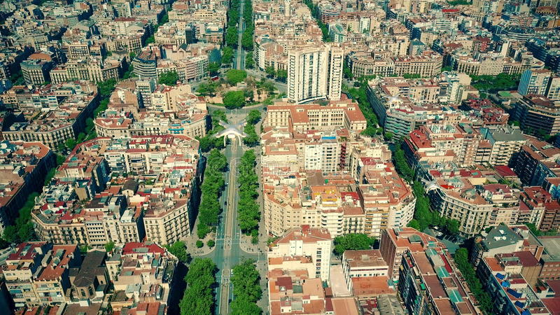 Aerial view of multiple drones flying and filming above Barcelona blocks pattern, Spain. 3D rendering royalty free stock photos