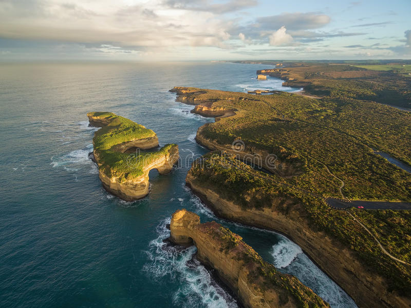 Aerial view of Mutton Bird Island arches and Elephant rock at sunrise royalty free stock images