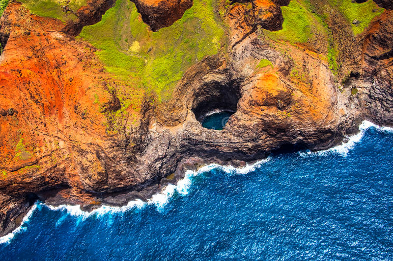 Aerial view of Na Pali coastline open ceiling cave from helicopter, Kauai stock image