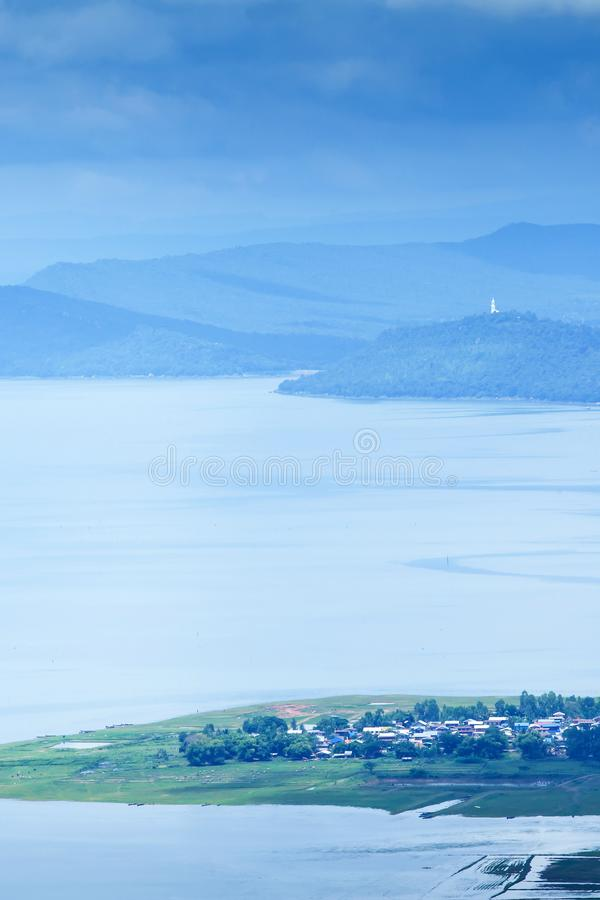 Aerial view of Nam Phong lake village on rainy morning stock image