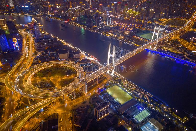 Aerial view of Nanpu Bridge, Shanghai Downtown, China. Financial district and business centers in smart city in Asia. Top view of stock image