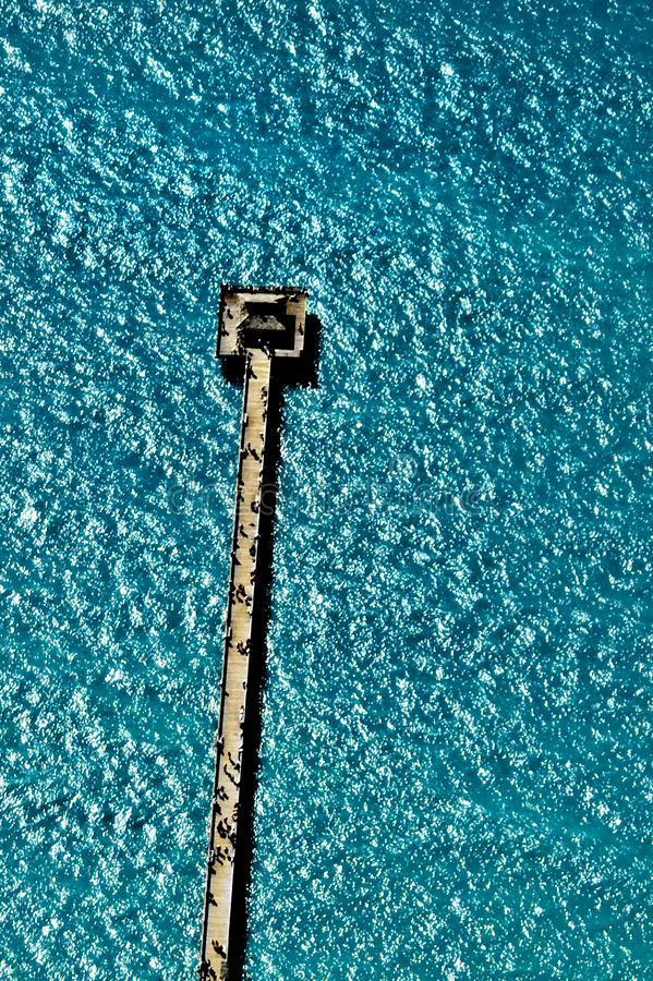 Aerial view of the Naples, Florida, pier jutting into the turquoise blue water of the Gulf of Mexico, taken from an airplane . stock image
