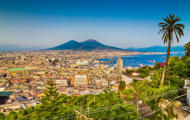 Aerial view of Napoli with Mount Vesuvius at sunset, Campania, Italy. Scenic picture-postcard view of the city of Napoli (Naples) with famous Mount Vesuvius in stock images