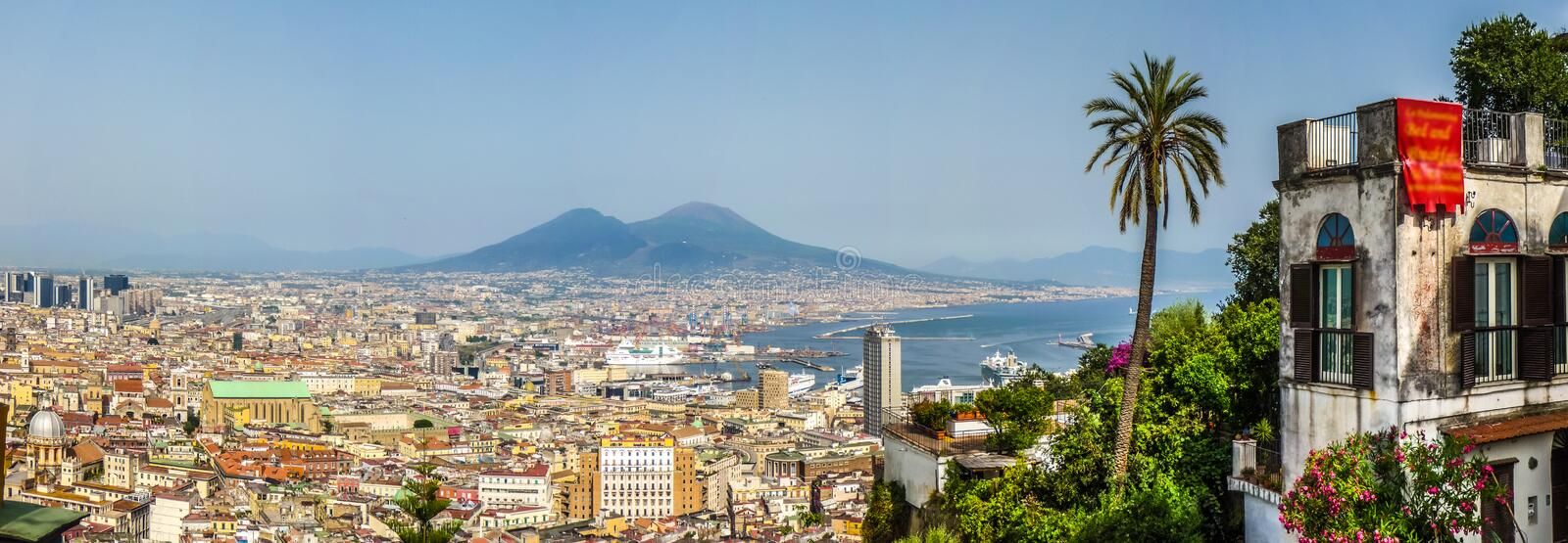 Aerial view of Napoli with Mount Vesuvius at sunset, Campania, Italy. Scenic picture-postcard view of the city of Napoli (Naples) with famous Mount Vesuvius in royalty free stock images