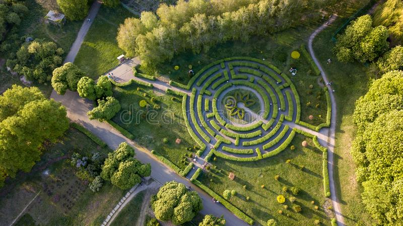 Aerial view a natural labyrinth in the botanical garden on a sunny day royalty free stock photo