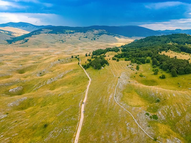 Aerial view of nature around village Vrdolje on the way to Lukomir in Bosnia and Herzegovina. Aerial view of nature around village Vrdolje on the way to Lukomir royalty free stock image