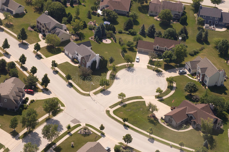 Aerial View Neighborhood Houses and Home in Cul De Sac. Cul de sac street of houses and homes in a neighborhood suburb. Each house and home are a modern suburban stock image