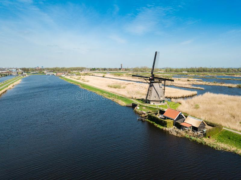 Aerial view of Netherlands rural landscape with windmills at famous tourist site Kinderdijk in Holland. Sunny spring day in count royalty free stock photo