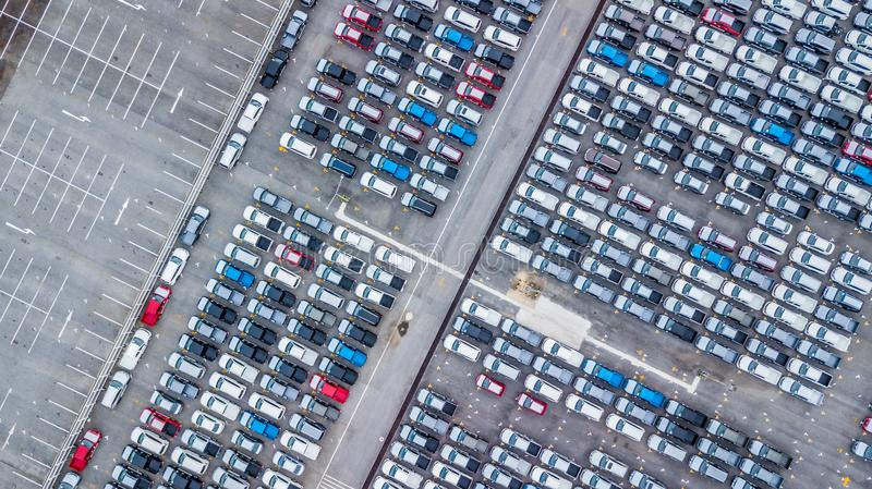 Aerial view new cars lined up in the port for import and export, Top view of new cars lined up outside an automobile factory for stock photos
