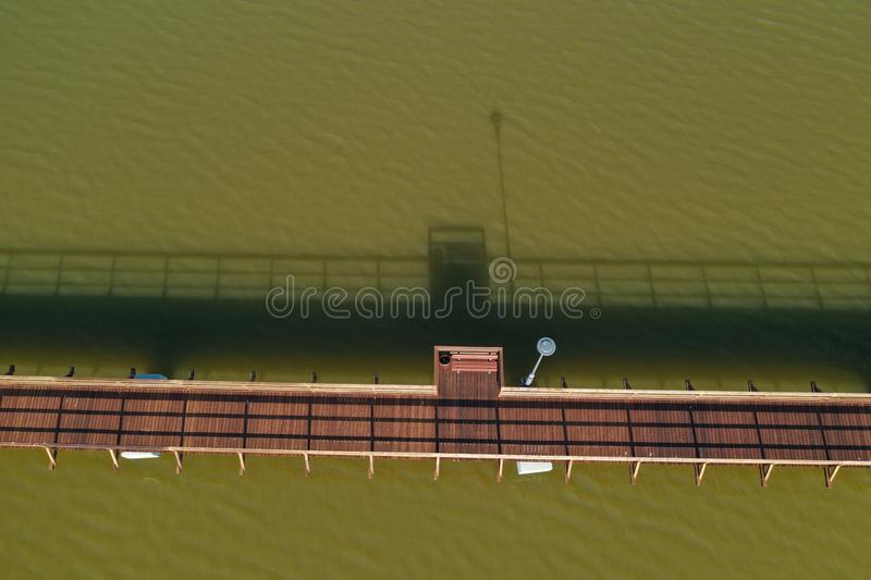 Aerial view of new wooden Bridge over a lake. Lithuania royalty free stock photography