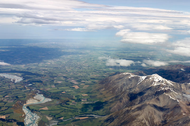 Aerial view of New Zealand mountains, South Island. Photo is taken from airplane heading from Sydney to Christchurch. stock photos