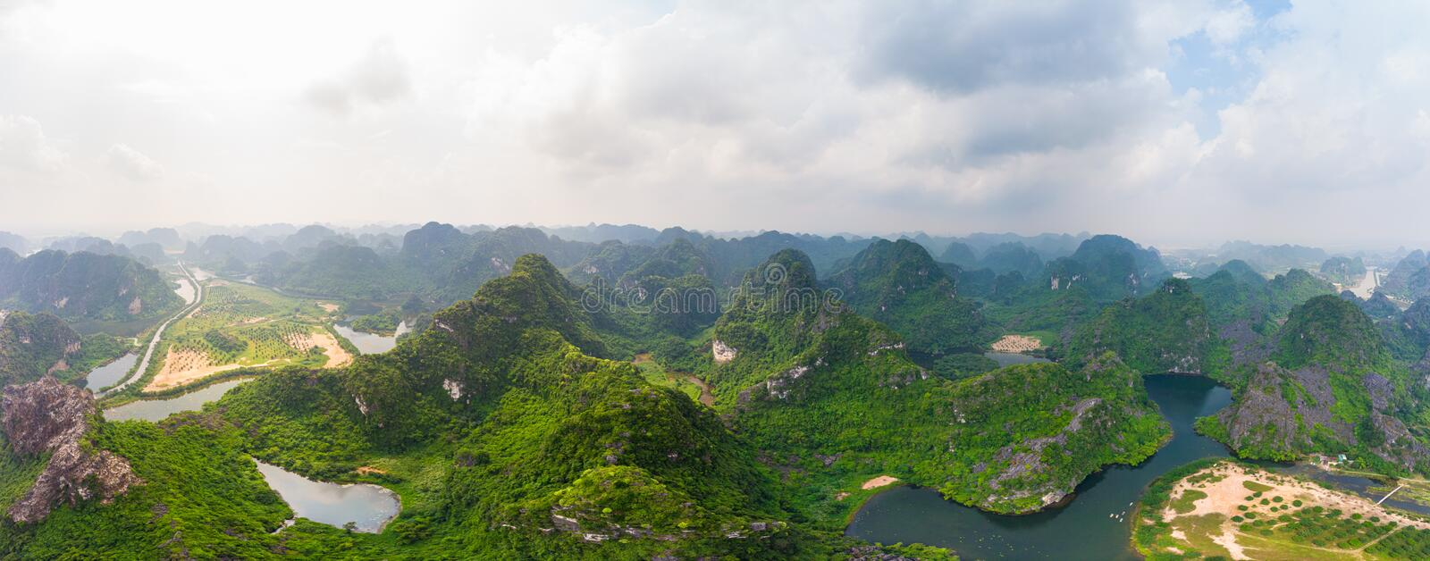 Aerial view of Ninh Binh region, Trang An tourist attraction, UNESCO World Heritage Site, Scenic river crawling through karst stock photo