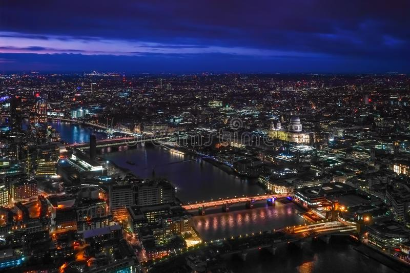 Aerial view of north east part of London, in evening. St Pauls Cathedral visible over river Thames stock photography