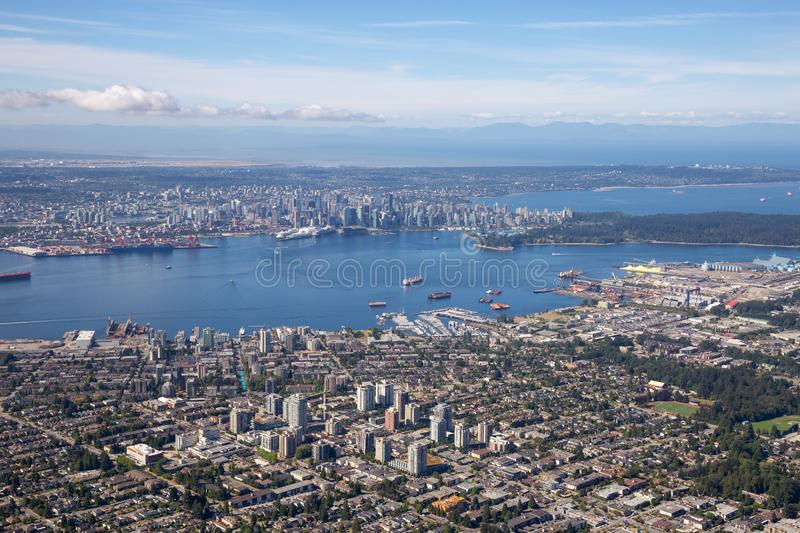 Aerial view of North Vancouver. BC, with Downtown City in the Background royalty free stock photography