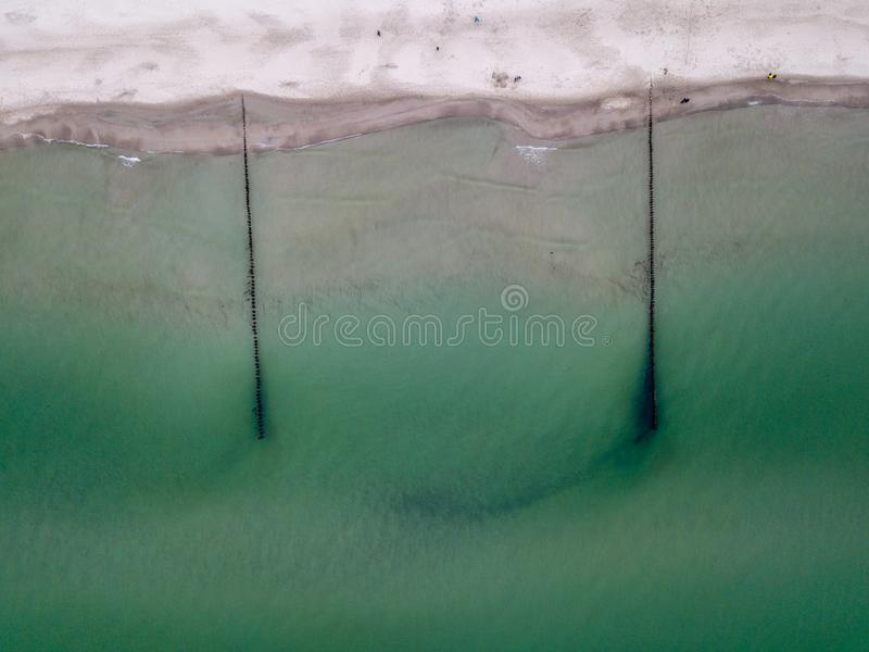 Aerial view of ocean and beach - shoreline. Of the baltic sea with groynes royalty free stock photo
