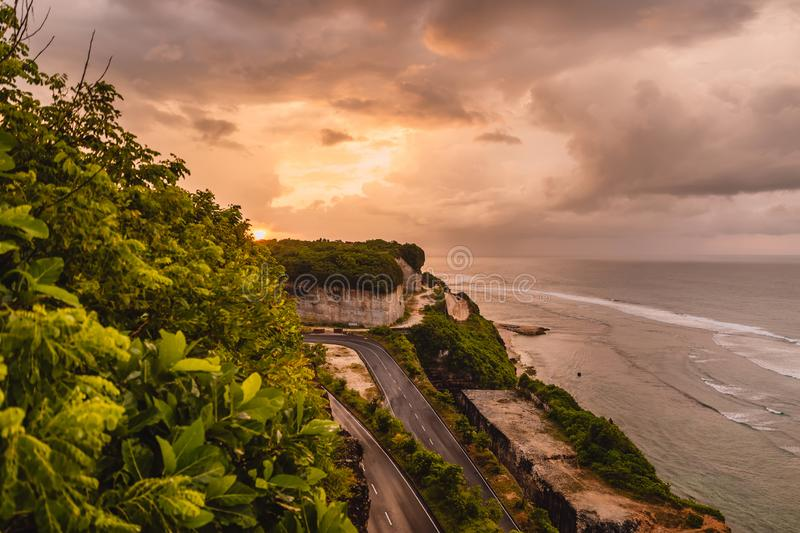 Aerial view of ocean coast with waves and warm sunset or sunrise. Aerial view of ocean coast with waves and warm sunset stock photo