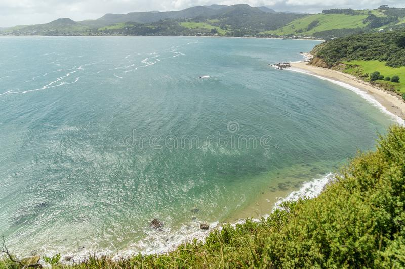 Aerial view of ocean coastline on sunny day, Omapere,. New Zealand stock photo