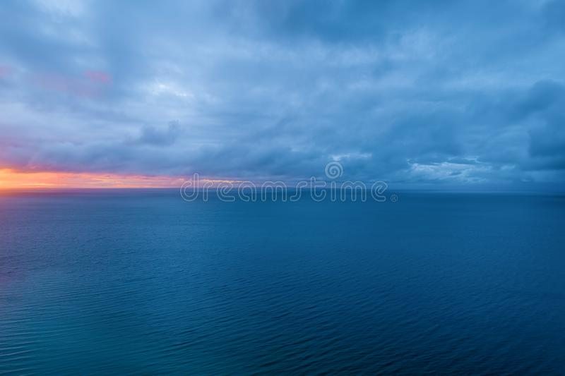 Aerial view of ocean at dusk. Aerial view of ocean at dusk, the border between sky and water disappears stock photos