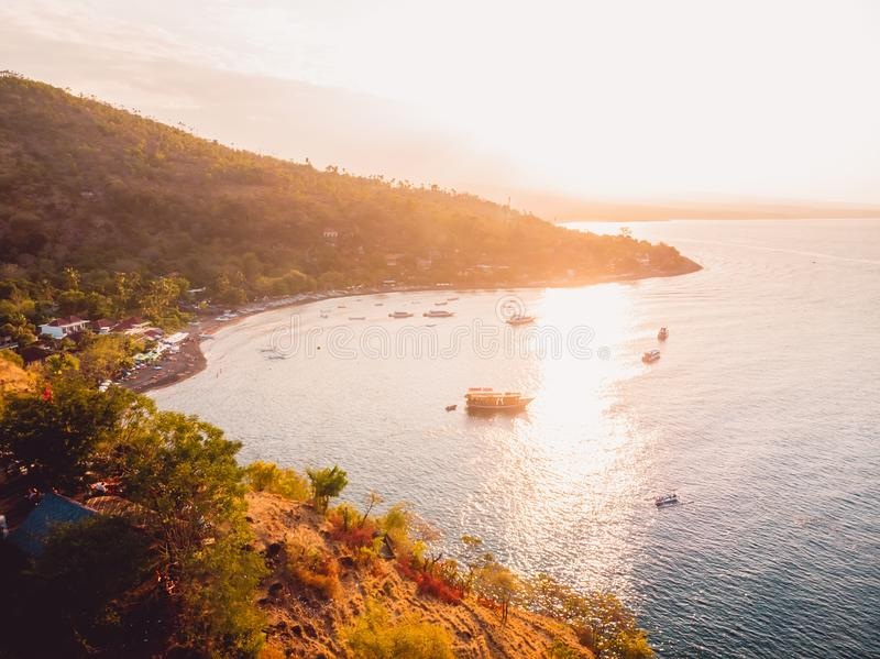 Aerial view of ocean with mountains and local boats in Amed, Bali stock photos