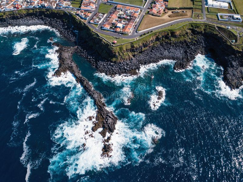 Aerial view of the ocean surf on the reefs coast of San Miguel island. Portugal royalty free stock photo