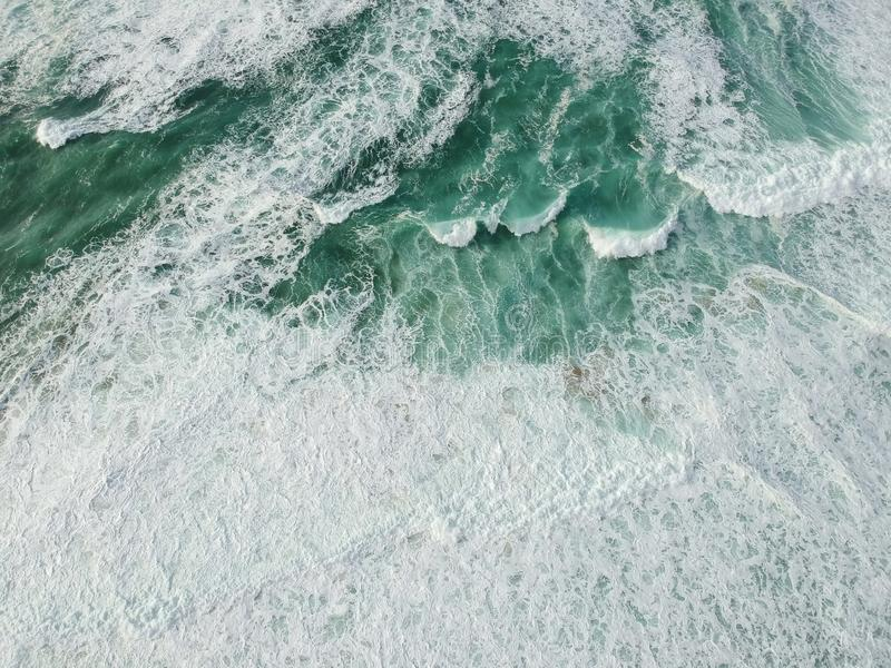 Aerial view ocean with waves. Portuguese coastline `Praia Grande` beach in Sintra. Drone photo royalty free stock images