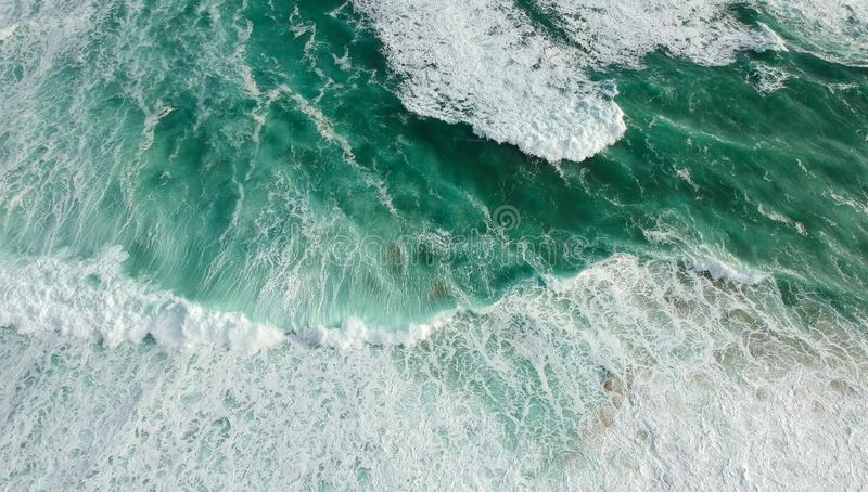 Aerial view ocean with waves. Portuguese coastline `Praia Grande` beach in Sintra. Drone photo stock photography