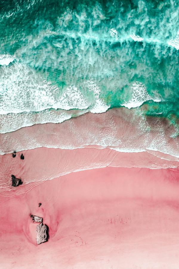Aerial View Of Ocean Waves And Beautiful Pink Sandy Beach. Shore royalty free stock photo