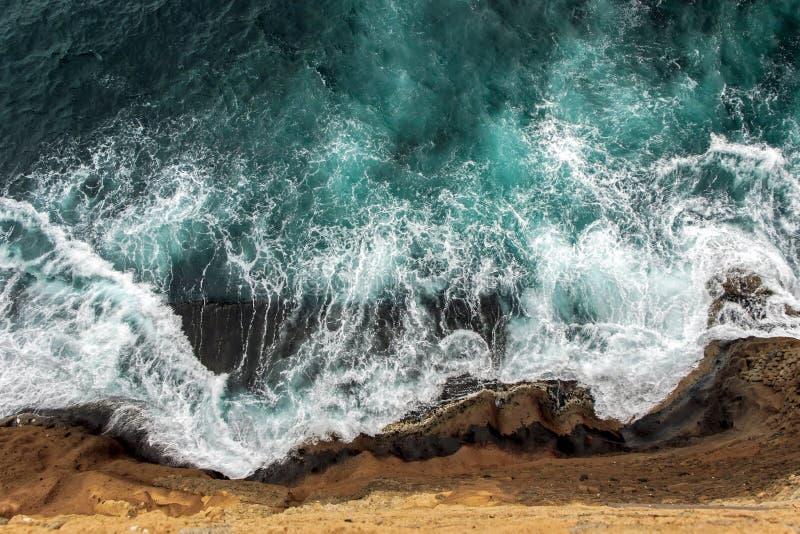 Aerial view of ocean waves on cliff. Aerial view of ocean waves wash up on cliff stock photography