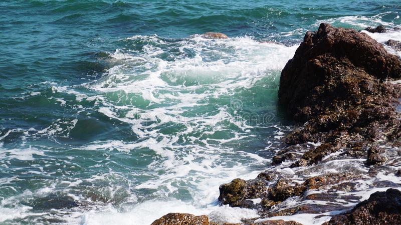 Aerial view of ocean waves and fantastic Rocky coast. Summer vacation and nature travel adventure concept royalty free stock photography