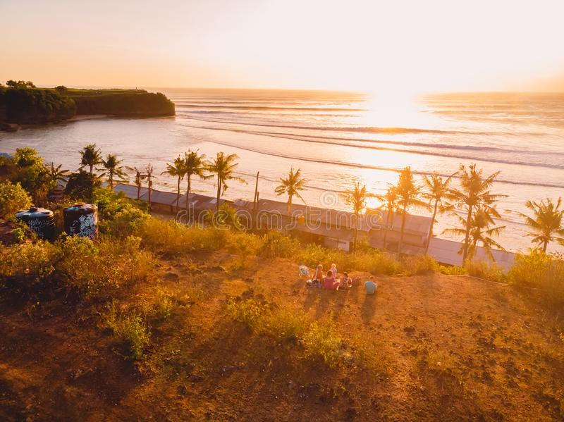 Aerial view of ocean with waves, palms and sunset in Bali. Balangan beach stock photo