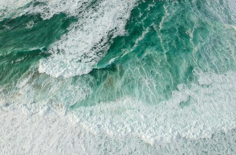 Aerial view ocean with waves. Portuguese coastline `Praia Grande` beach in Sintra. Drone photo stock photos
